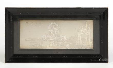An early 20th century Chinese silver plaque in ebonized strut frame. Depicting a river scene with