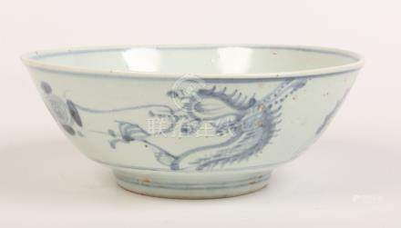 A Chinese Swatow ware bowl probably 17th century. Painted in underglaze blue with a dragon and