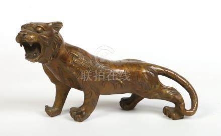 A Chinese bronze model of a tiger. Decorated to his flanks with ancient Chinese coins, 35cm.