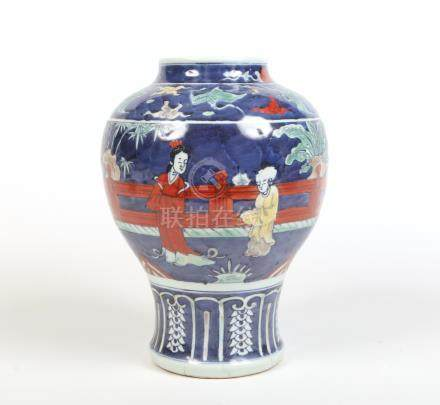 A 20th century Chinese baluster wucai vase. Ground in underglaze blue and decorated with figures