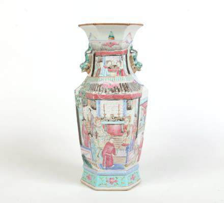 A 19th century Chinese famille rose hexagonal baluster vase. With moulded twin handles formed as