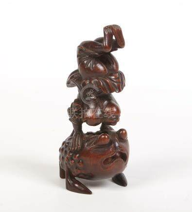 A Chinese carved bamboo figure of Liu Hai in acrobatic pose supported on the back of a toad, 19cm.