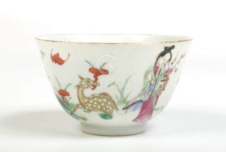 A 19th century Chinese famille verte bowl. Painted with two maidens, a deer and a crane in a