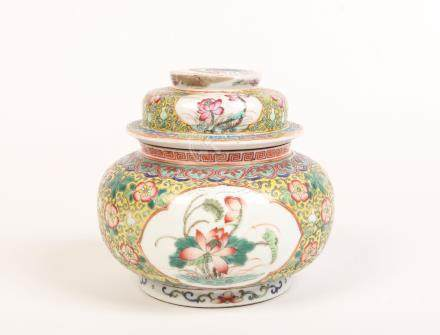 An early 20th century Chinese bowl and cover. Yellow ground with stylized lotus scrolls and having