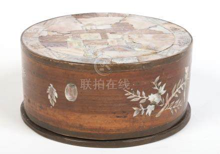 A 19th century Cantonese hardwood workbox of drum form with fitted internal tray and brass mounted