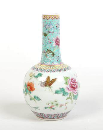 A 20th century Chinese famille rose bottle vase. With turquoise ground neck painted with lotus