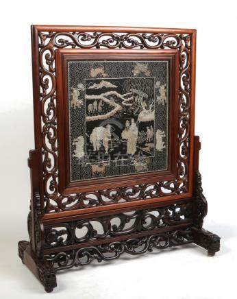 A late Qing dynasty large Chinese hardwood scholars screen. Carved with open scrollwork, raised on