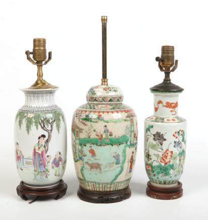 A 19th century Chinese famille verte rouleau vase converted to a tablelamp along with two similar,