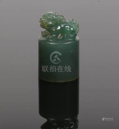 A Chinese miniature carved jade seal fob. With a dog of fo terminal and carved characters to the