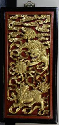 Republic wood lions in a wood frame, painted gold and connected to clouds and intricate swirl patterns
