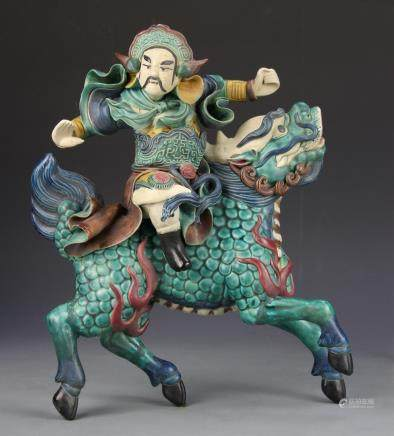 Faha warrior figure riding a Kylin, depicted in a state of motion, and painted in bright color and detail.