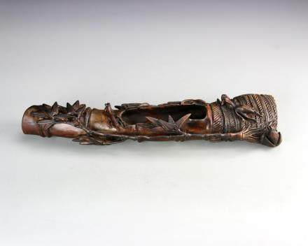 19th Century carved Zitan brush washer, in the form of a stalk of bamboo with a central well, decorated with leaves and insects.