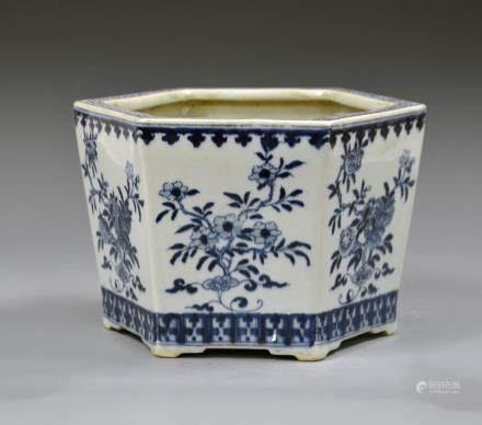 19th C., blue and white planter, in hexagonal form, with bands of patterned detail around the base and rim, and floral motifs on each side