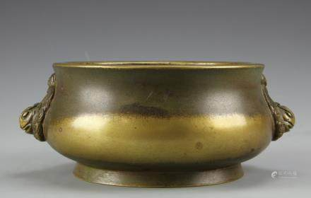 Republic bronze censer, with a flared rim, and raised, flared base, with attached ears on each side in the form of simplistic lions faces, mark on base.