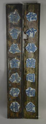 Qing dynasty, a pair of blue and white couplets, wood base with ceramic characters, with floral design and white back drop.