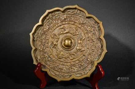 A fine CARVED BRONZE MIRROR