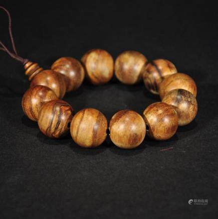 A string of HUANGHUALI WOOD BEADS BRACELET