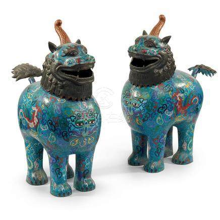 A pair of Chinese cloisonné polychrome enamel figures of a F