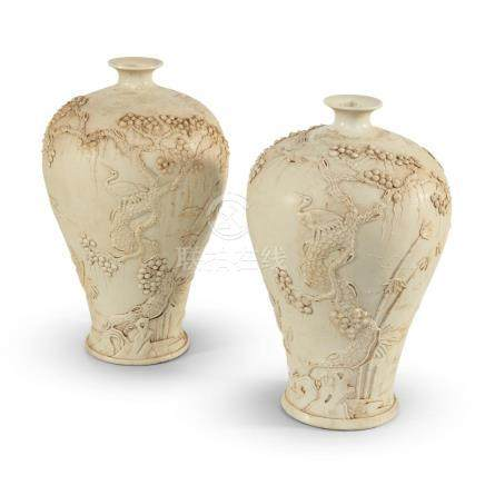 A pair of Chinese white porcelain vases