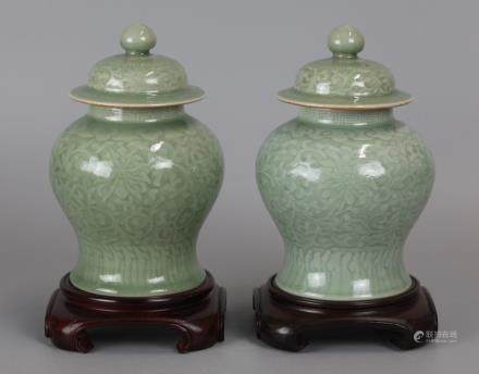 pair of Chinese celadon porcelain cover jars 19th c.