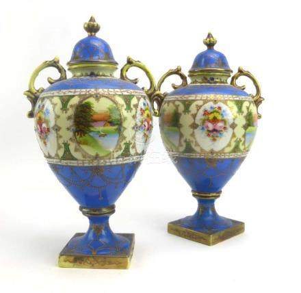 A pair of Japanese Kinjo China two handled covered vases decorated in the European manner with