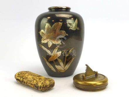 A Japanese metalware vase of shouldered ovoid form decorated with a song bird and lily, h.
