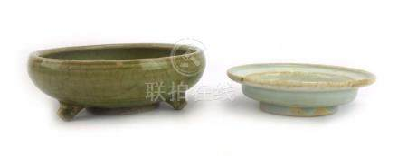 An early Chinese shallow dish of unusual circular form, decorated in a plain celadon crackle glaze,
