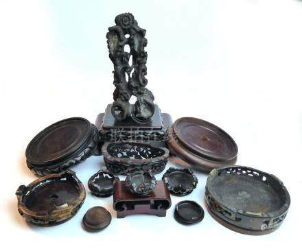 A mixed group of carved Oriental stands,