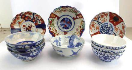 A set of three blue and white stoneware dishes decorated in an 'onion' type pattern, d.
