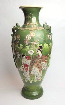 A Japanese satsuma vase of shouldered form decorated with geisha within a green ground h. 47.