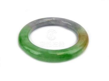 A pale green/brown jade-type bangle, internal d. 5.