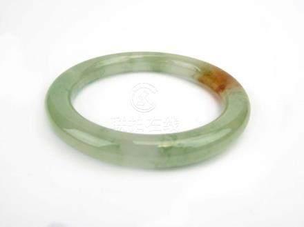 A pale green/brown jade-type bangle, internal d. 6.