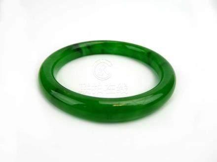 A green jade-type bangle, internal d. 5.