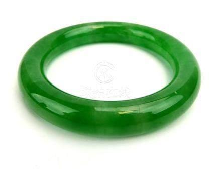 A green jade-type bangle, internal d. 6.