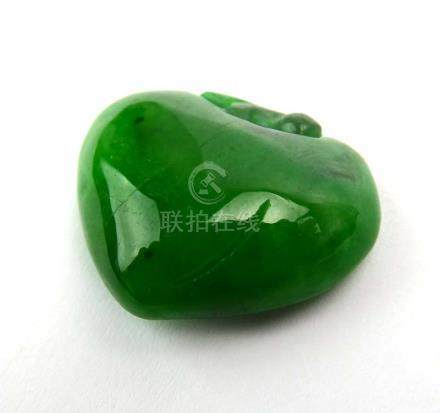 A carved green jade-type pendant of heart shaped form l. 2.