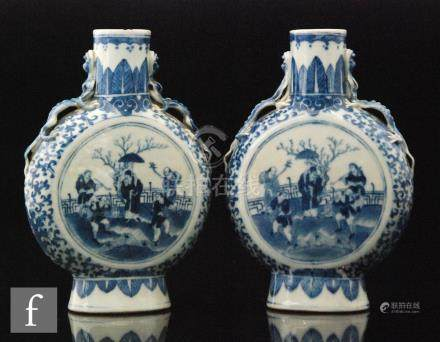 A pair of Chinese Kangxi style blue and white moonflasks, late Qing Dynasty (1644-1912),