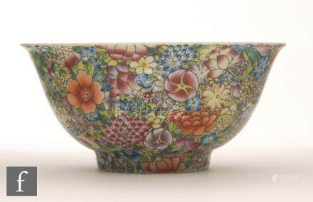 A Chinese Millefleur style bowl of 'U' form, raised on high footring,