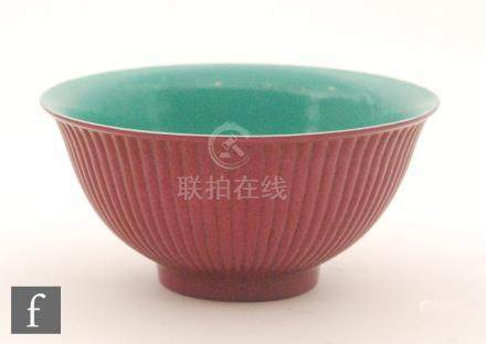 A Chinese magenta glazed lobed bowl of circular form with ribbed exterior sides,