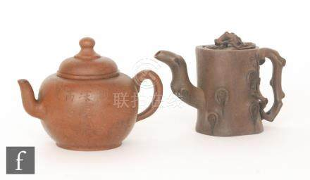 Two Chinese Yixing style teapots, the first of globular form with domed top and finial,