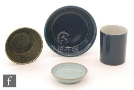A collection of Chinese glazed wares to include a blue monochrome glazed brushpot and everted rim