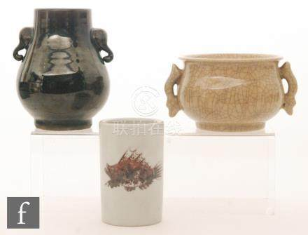 A collection of Chinese glazed wares to include an aubergine glazed pear-shaped vase with twin