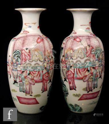 A pair of late 19th to early 20th Century Chinese export famille rose vases,