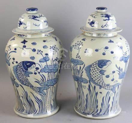"Pair of Chinese porcelain temple jars having koi fish scenes, 19"" H x 12"" diameter. Provenance:"