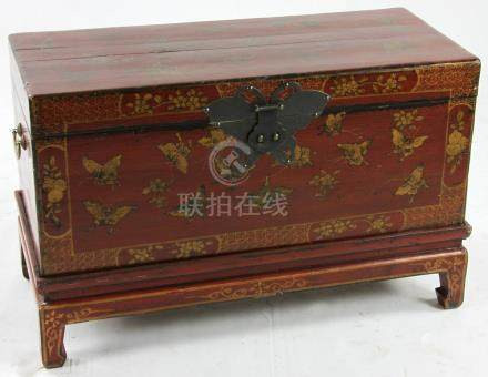 Chinese chest on short legs, reddish finish with gilt butterflies, large brass latch, brass end