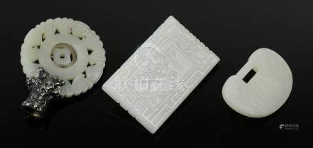 """Three pieces of Chinese jade, plaque 2 3/4"""" x 1 3/4"""", 1 1/2"""" x 2"""", and 2 1/4"""" dia. Provenance: New"""