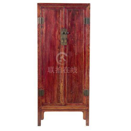 HARDWOOD CABINETQING DYNASTY, 19TH CENTURY with two single panel doors, resting on slightly