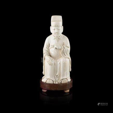WELL CARVED IVORY FIGURE OF A SEATED OFFICIALLATE QING DYNASTY portrayed in Ming-style attire and