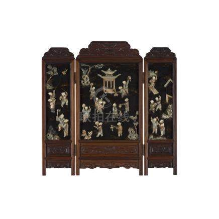 IVORY-INLAID THREE-FOLD WOODEN TABLE SCREENLATE QING DYNASTY finely inlaid in ivory with boys