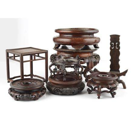 COLLECTION OF WOODEN STANDSMOSTLY LATE QING DYNASTY/REPUBLIC PERIOD comprising eight stands of