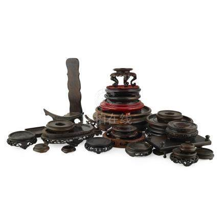COLLECTION OF WOODEN STANDS19TH/20TH CENTURY of varying sizes, mostly circular, two display stands
